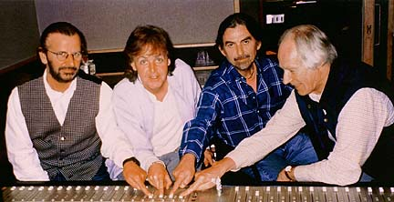 Harrison, McCartney, Starkey & Martin use a ouija board to ask John for more songs...