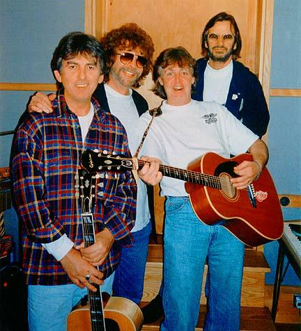 Paul is the only person in the studio brave enough not to cover up the white Wings t-shirt he has insisted they all wear...